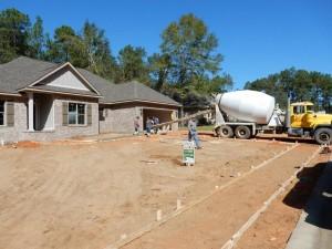 Start pouring house sidewalk